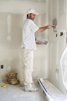 Drywall repair being performed by an experienced Menjivar's Painting drywall technician.